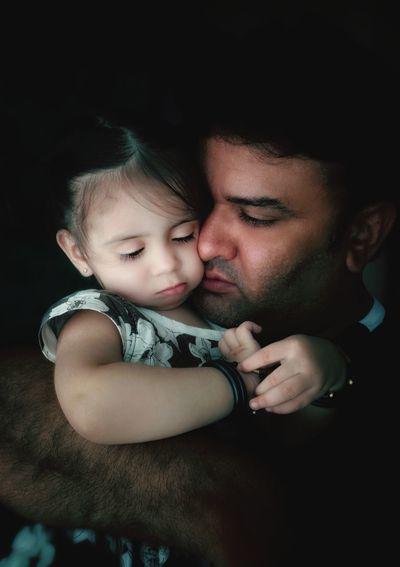 Close-up of father embracing daughter