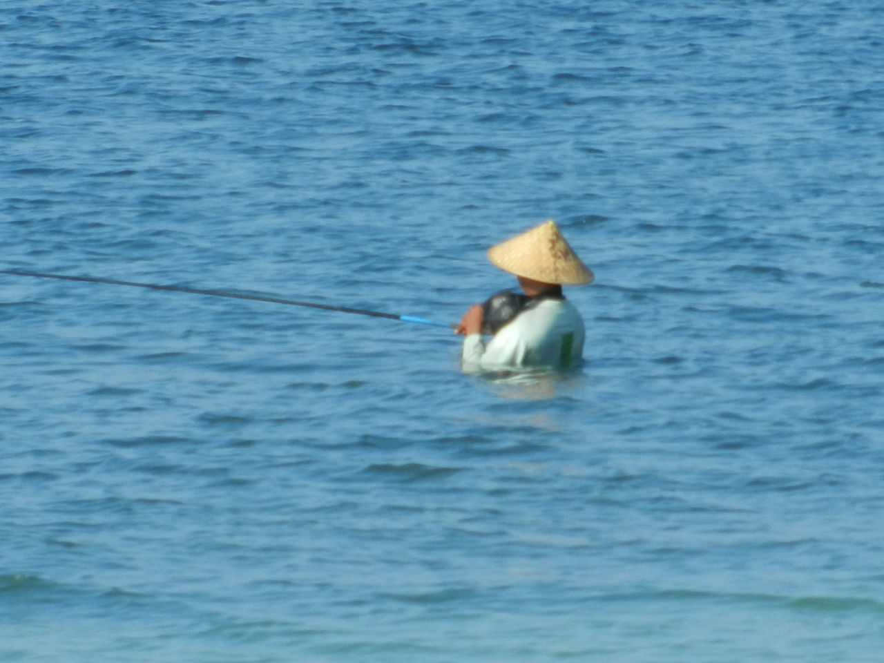 water, fishing, hat, sea, one person, holding, outdoors, day, rear view, real people, oar, asian style conical hat, waterfront, nature, fishing pole, fishing tackle, nautical vessel, rowing, adult, people