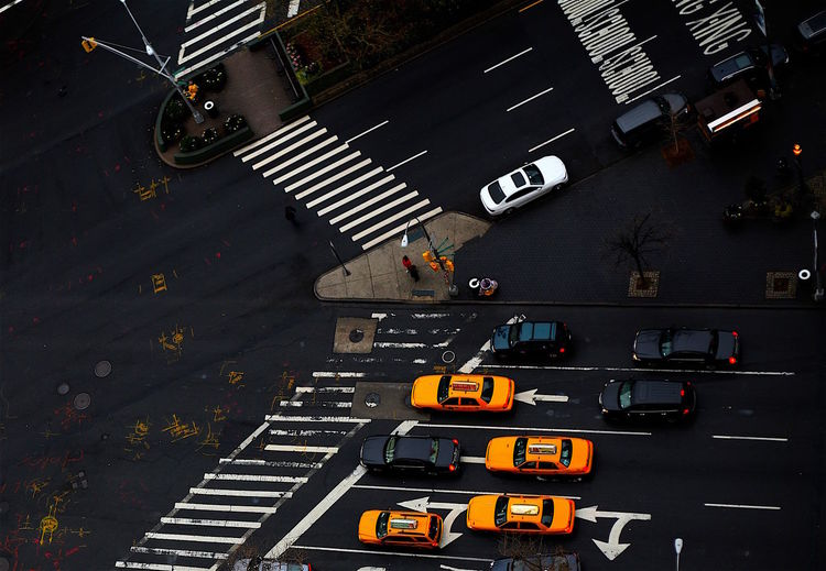 crosswalks and intersections/NYC Architecture Building Exterior Built Structure Car City City Life City Street High Angle View Land Vehicle Mode Of Transport On The Move Outdoors Road Road Marking Street Traffic Transportation Travel Yellow Zebra Crossing Welcome To Black