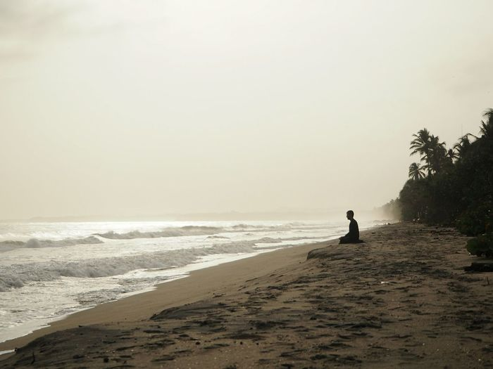 Meditate Meditation Meditate Zen Water Sea Full Length Beach Sand Silhouette Wave Sand Dune Men Sitting Tranquil Scene Tranquility Idyllic Remote Coast Scenics