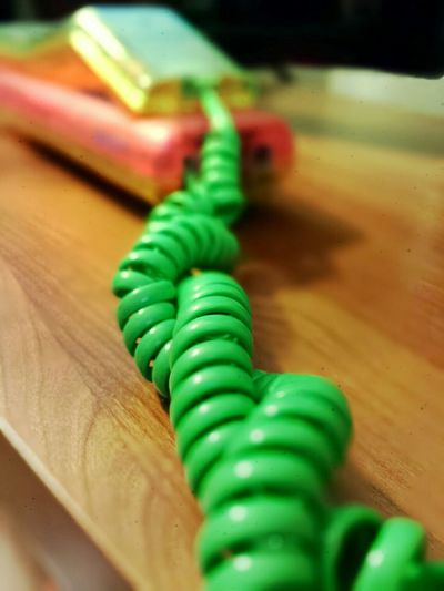 Coil wire of toy telephone on table