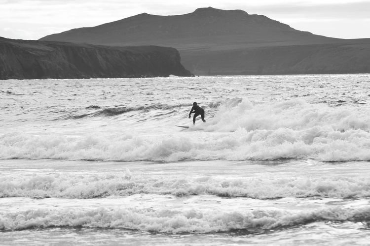 Surf Surfer EyeEm Selects Wales Pembrokeshire Blackandwhite Mountain Desert Men Adventure Sport Full Length Sand Dune Sky Landscape Coast Surfing Water Sport