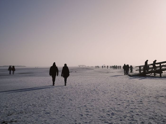 People On Beach During Winter