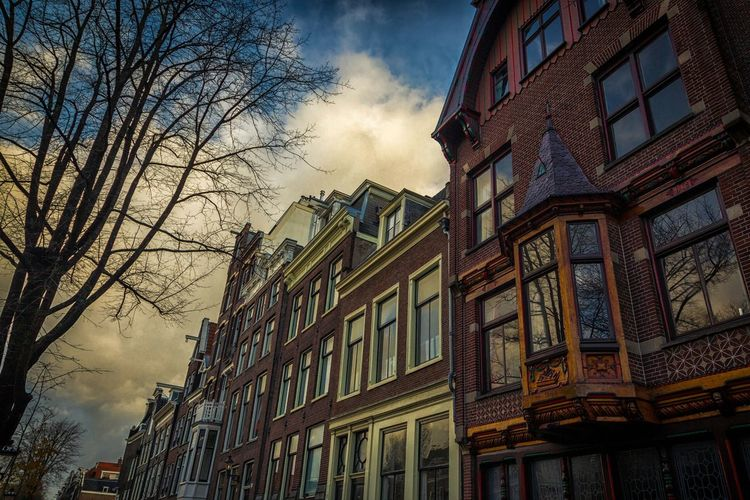 Building Exterior City Architecture Built Structure Travel Destinations Outdoors Clouds & Sky Canon5dmarkiii Amaterdamnoord Canal Walks Amsterdam Streets Amsterdamthroughmycamera Canals Of Amsterdam Canonlenses Amsterdam Canal Cinema In Your Life Amsterdamcity Film Photography Black & White Photography Canon 70d Trees And Nature Bicyle Amsterdam Amsterdam.nl Bicyclist