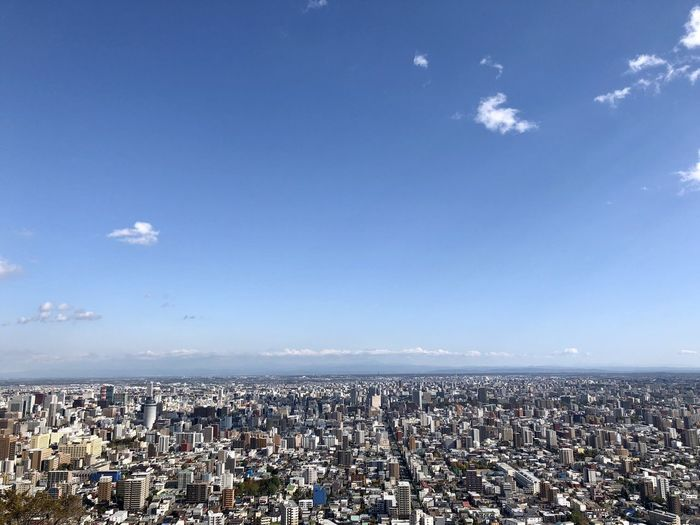 Building Exterior Architecture City Cityscape Sky Built Structure Building Nature Aerial View Day Blue High Angle View Horizon Travel Destinations Outdoors TOWNSCAPE Spectator Sapporo Hokkaido Japan Journey Journeyphotography Travel Adventure Journalism