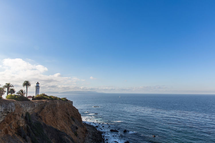 Lighthouse Lighthouses Architecture Beauty In Nature Blue Building Exterior Built Structure Copy Space Day Direction Guidance Horizon Horizon Over Water Land Lighthouse Nature No People Outdoors Scenics - Nature Sea Sky Tower Water