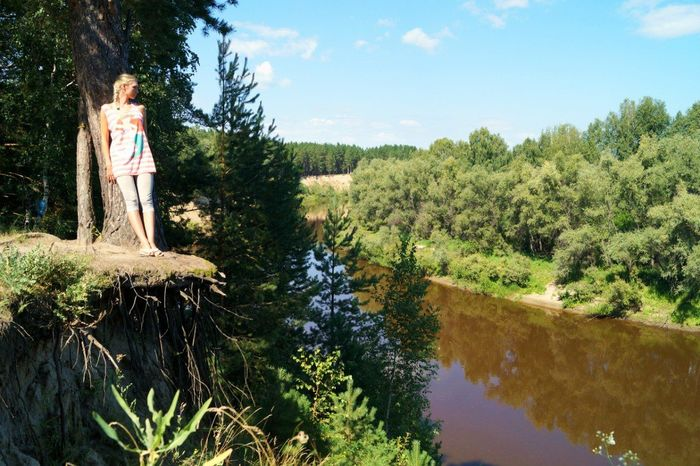 Girl on high dangerous bank off siberian river Beauty In Nature Dangerous Superior River Cliff Girl Girl On Steep Beach High Dangerous Bank Off River Nature River Cliff River Tara Steep Beach Tree