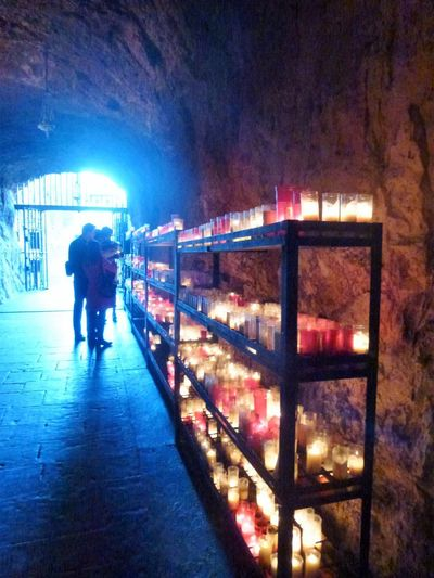 Candles In The Grotto Kerzen In Der Grotte Mountain Church Architecture Built Structure Eternal Light Ewiges Licht Full Length Illuminated Indoors  Lighting Equipment Men Mountain Chapel Night One Person People Real People Rock And Light Rock Gear Standing Walking