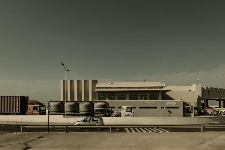 Airport runway against sky in city