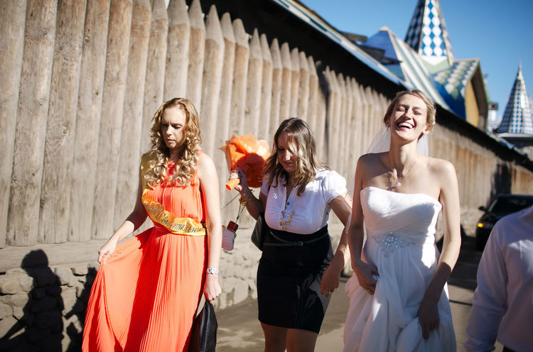 Adults Bridesmaid Day Fashionable Friends Group Happy Laughing Marriage  Married Matrimony Mother Newlywed People Three Together Walking Wedding Women