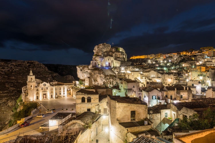 The Sassi of Matera at night : The Most Spectacular City in Italy. Unesco Heritage and European Capitol of Culture 2019 Sasso Caveoso, San Pietro e Paolo Church Architecture Cities At Night Cities At Night Eyeem Awards 2016 Cloud Cloud - Sky Elevated View Illuminated Landscapes With WhiteWall Matera Matera Italy Matera2019 Night Night Lights No People Old Town Outdoors Residential Structure TOWNSCAPE Travel Destinations Weather 43 Golden Moments