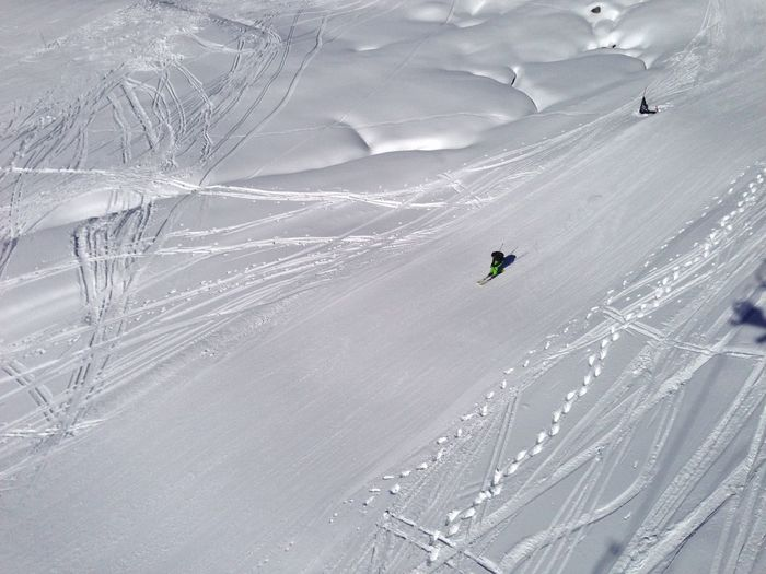 Person Skiing On Snowcapped Mountains