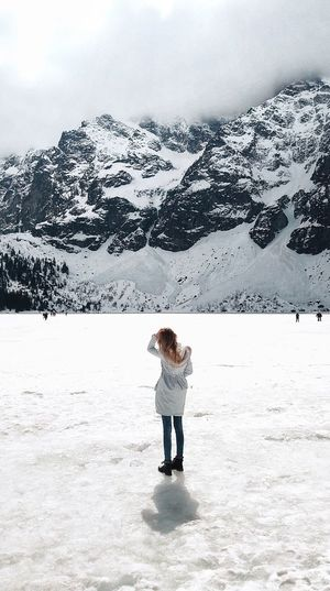 Human and the earth. Breathtaking Earth Small Man In A Big World Poland Tatras Full Length One Person Real People Standing Leisure Activity Lifestyles Nature Scenics - Nature Beauty In Nature Snow Winter Outdoors Land