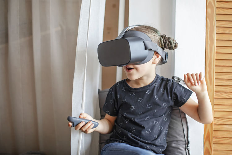 Cute girl using vr at home