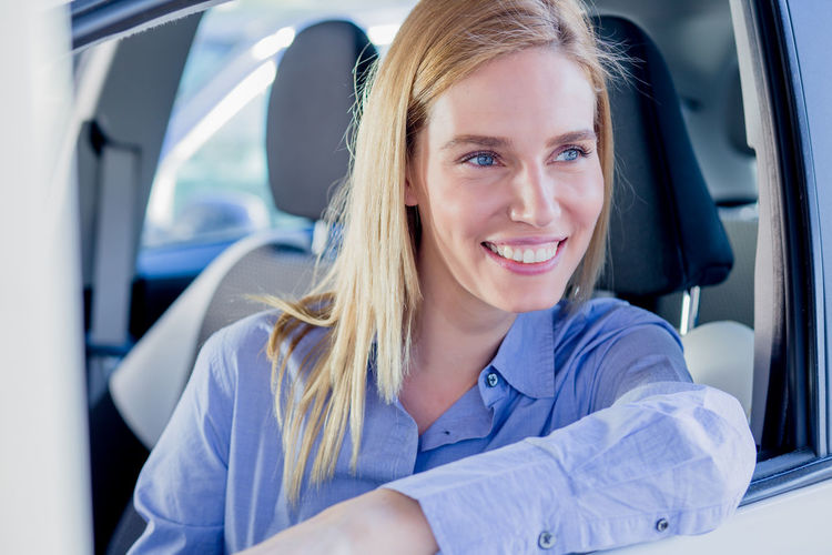 Close-up of woman sitting car