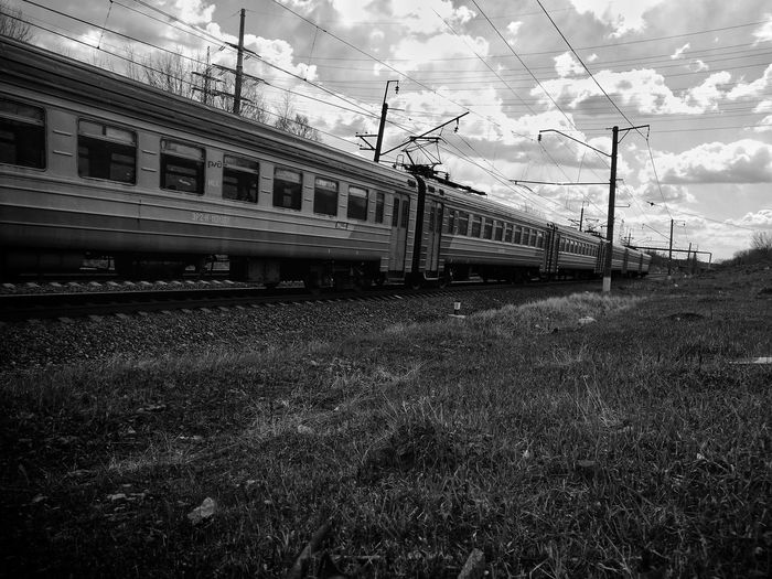 Train on field against sky