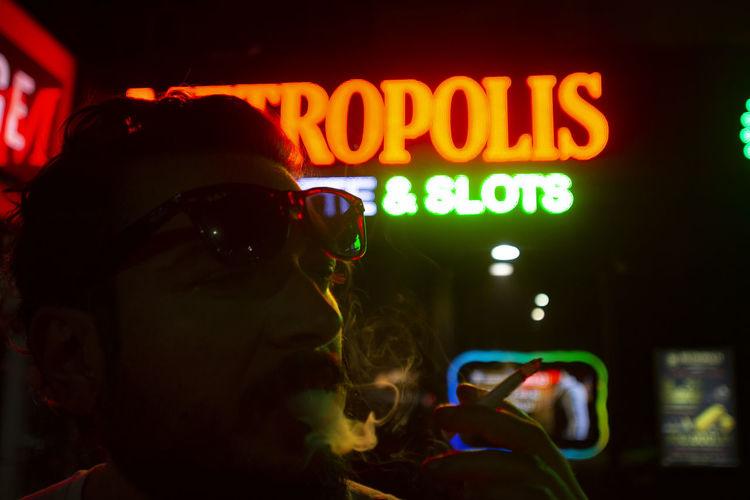 smoking mirrors EyeEm Best Shots EyeEm Gallery HUAWEI Photo Award: After Dark Communication Glasses Illuminated Lifestyles Men Neon Night Nightlife Portrait Real People Sunglasses