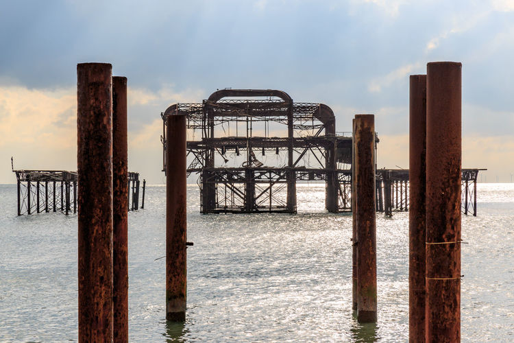 West Pier, Brighton Brighton Derelict Rust Sunlight Sussex Coast Abandoned Architecture Beach Beauty In Nature Built Structure Cloud - Sky Day Nature No People Old Outdoors Sand Sea Sky Sussex West Pier