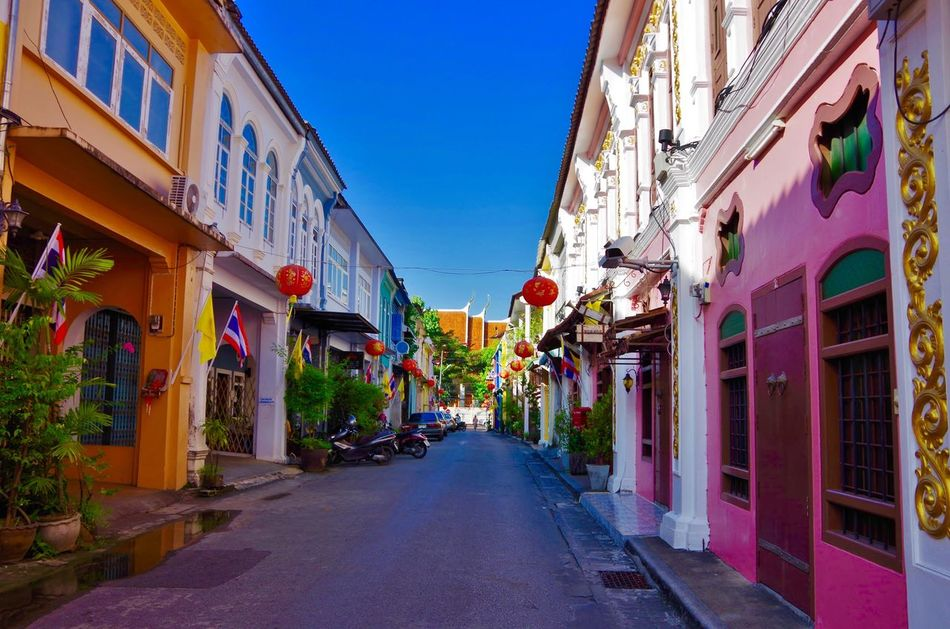 Pretty Phuket Old Town Alley Architecture Building Exterior The Way Forward Day No People Clear Sky Phuket Old Town Chino-Portuguese Alley Street Photography Thailand Cultures Multi Colored Colour Of Life Traditional Architecture Sky Town Thailand_allshots Houses Blue Sky Colorful Lantern Flag Phuket Old Town Let's Go. Together. EyeEm Selects