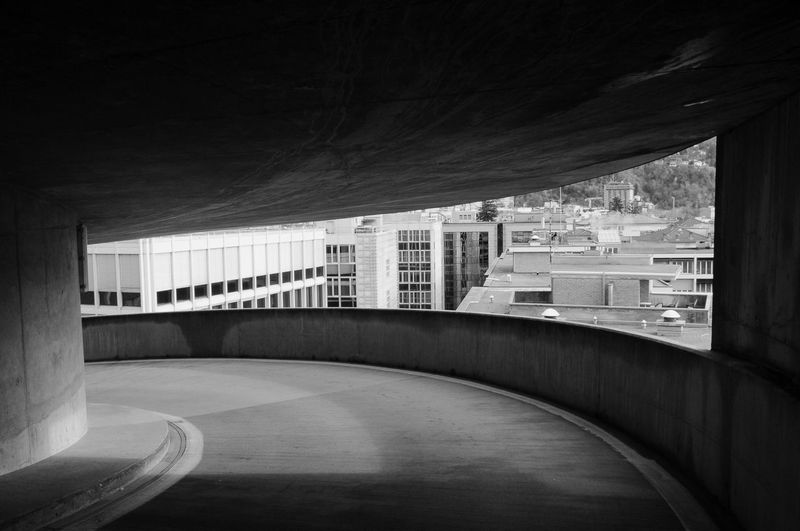 Empty modern buildings in city against sky