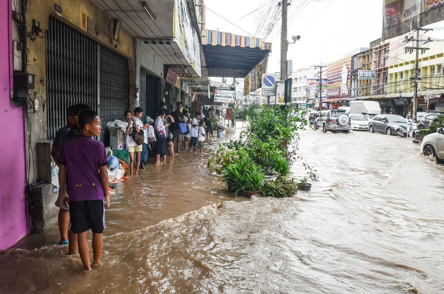 SRIRACHA, THAILAND - October 29 : Flood after heavy rain in Sriracha, Chonburi, Thailand on 29 October 2016 Bus Stop City City Life Day Flood Large Group Of People Lifestyles Outdoors People Real People Road Street Town Transport Walking Water Wet