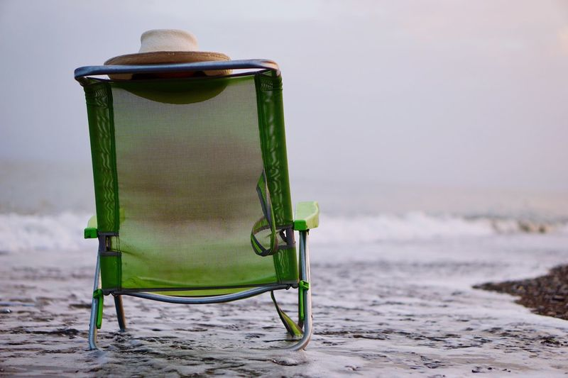 Beach Absence Sand Outdoors No People Day Green Color Nature Sky Sand Chair
