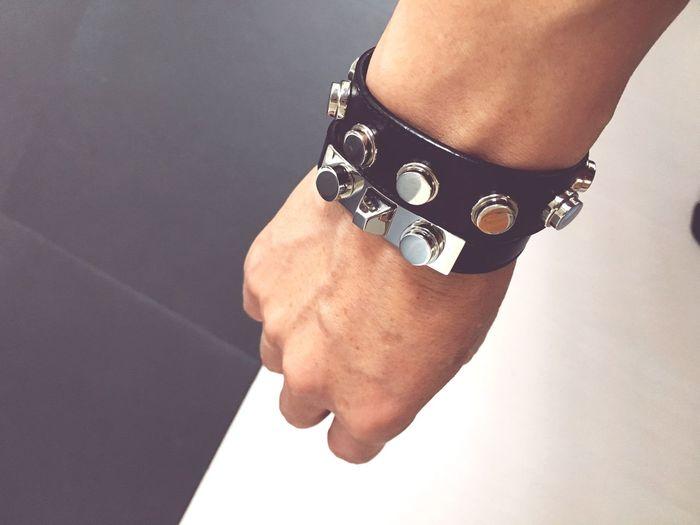 Close-up of man wearing bracelet