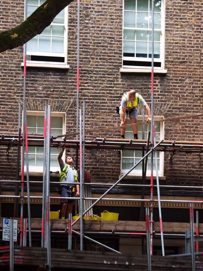 Scaffolders. Shaftesbury Avenue. London. 12-07-2017 Steve Merrick Street Photography Street Scaffolder, Workman, High Up, Stevesevilempire Olympus London News Workmen Scaffolding Builders Zuiko