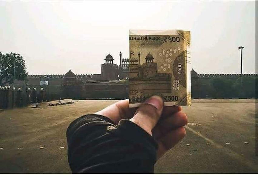 Indian rupees.. And its origin heritage place.. Human Hand Prisoner Handgun Sky