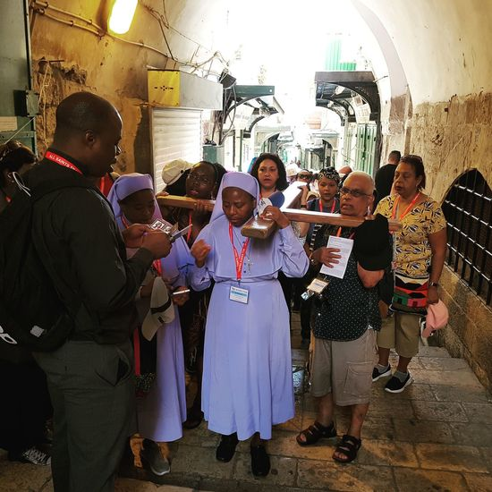 Architecture Palestine Daily Life Religion Christianity Saxophone Friendship Musical Instrument Musician Full Length Standing Party - Social Event Togetherness Arts Culture And Entertainment Men