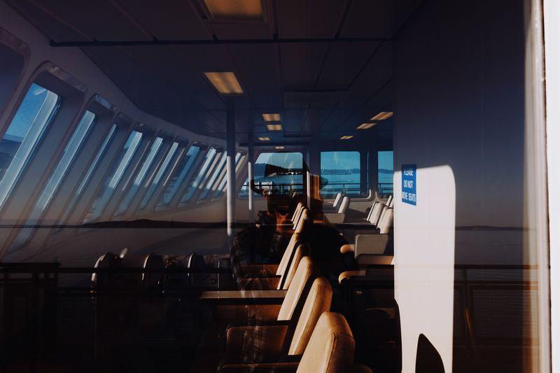Man sitting in bus against sky