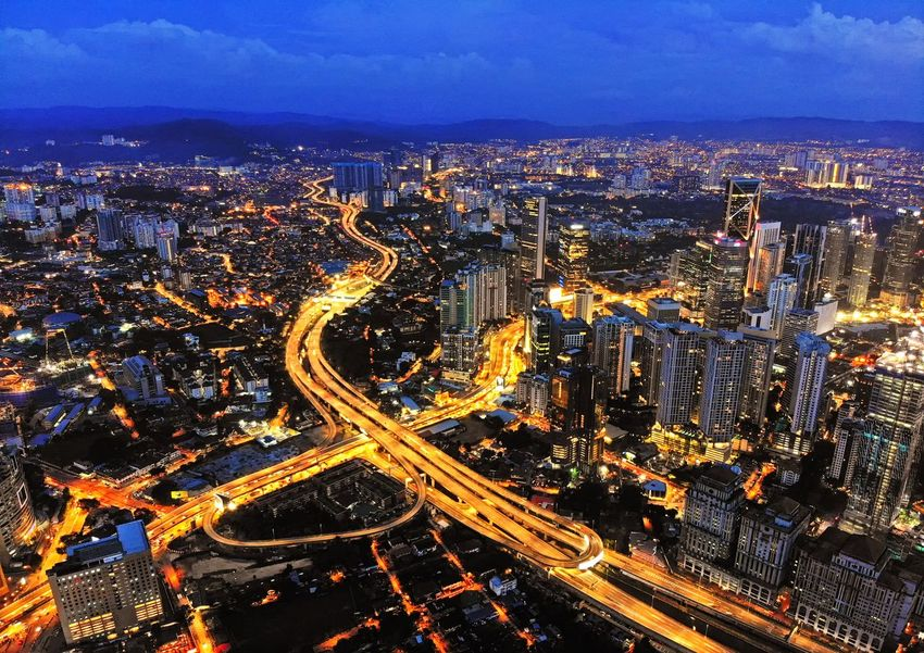 Kuala Lumpur city lights during blue hour Cityscape Downtown District Business Architecture Kuala Lumpur EyeEm Best Shots Eyeemphotography Aerial View EyeEm Selects EyeEm Gallery Aerial Photography Landscape Outdoors Beautiful Travel Travel Destinations Cityscape City Illuminated Aerial View Road High Angle View Sky Landscape Light Trail Vehicle Light Long Exposure Light Painting Moving Traffic
