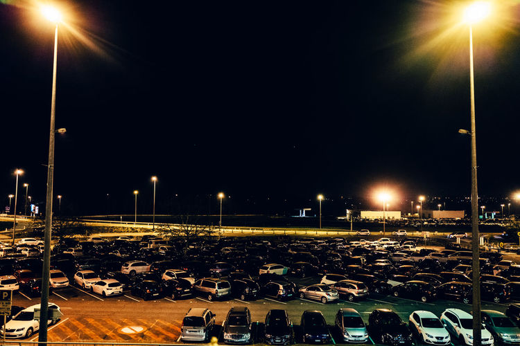 Absence Airport Basel Basel Mulhouse Clear Sky Copy Space Empty Glowing Illuminated In A Row Lens Flare Light - Natural Phenomenon Lighting Equipment Mode Of Transport Night No People Outdoors Parking Lot Road Sky Street Street Light Transportation