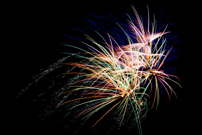 Fireworks on black night sky. Firework Display Photos. Arts Culture And Entertainment Celebration Celebration Event Event Exploding Firework Firework - Man Made Object Firework Display Illuminated Long Exposure Low Angle View Motion Multi Colored Night No People Outdoors Sky Sparkler Sparks
