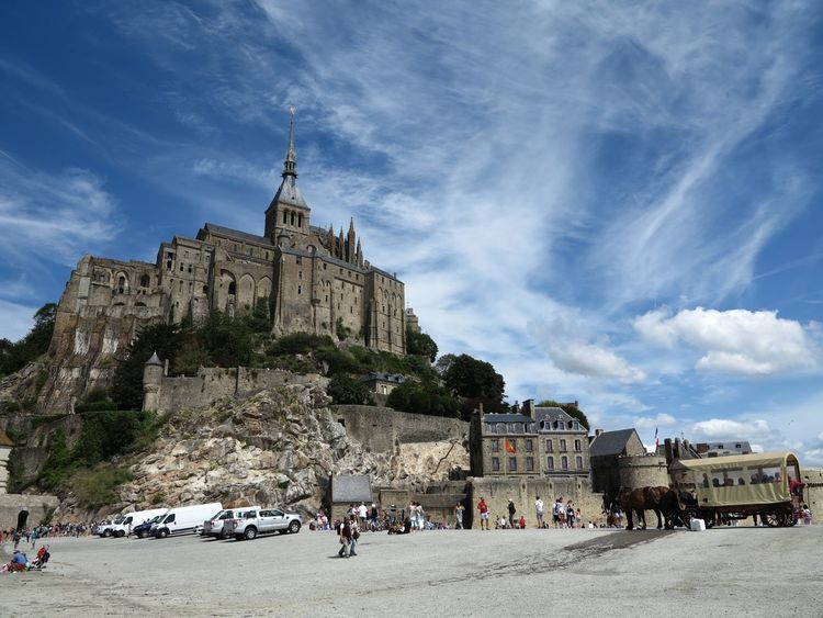 Mont-Saint-Michel Ancient Ancient Civilization Architecture Blue Building Exterior Built Structure Cloud - Sky Day History Large Group Of People Leisure Activity Lifestyles Low Angle View Nature Outdoors People Place Of Worship Real People Religion Sky Spirituality Tourism Travel Travel Destinations Vacations