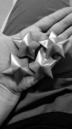 Midsection of person holding star shape decoration