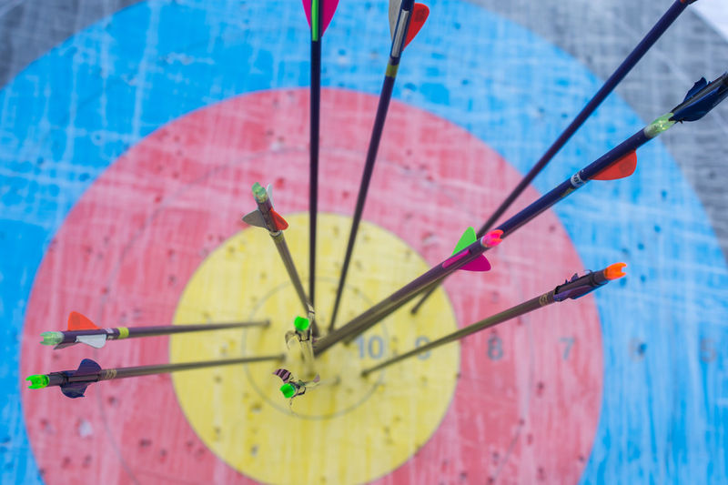 Accuracy Arrow - Bow And Arrow Art And Craft Blue Clock Close-up Creativity Day Focus On Foreground High Angle View Indoors  Multi Colored Nature No People Pattern Pink Color Still Life Water Yellow