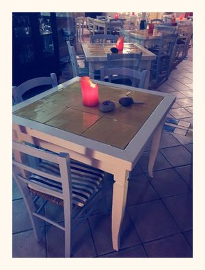 Sant'angelo Tables Candle Dinner Lines And Shapes Chair Stripes Cushion Tiles Stone