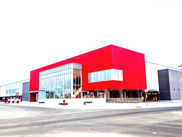 Brand new and already vacant Target Canada store. Urban Geometry Architecture Façade Red Modern Building Built Structure Store Urbanphotography Outdoors Retail Store Urban Landscape Suburban Landscape Targetcanada Winnipeg Winter Morning Sky