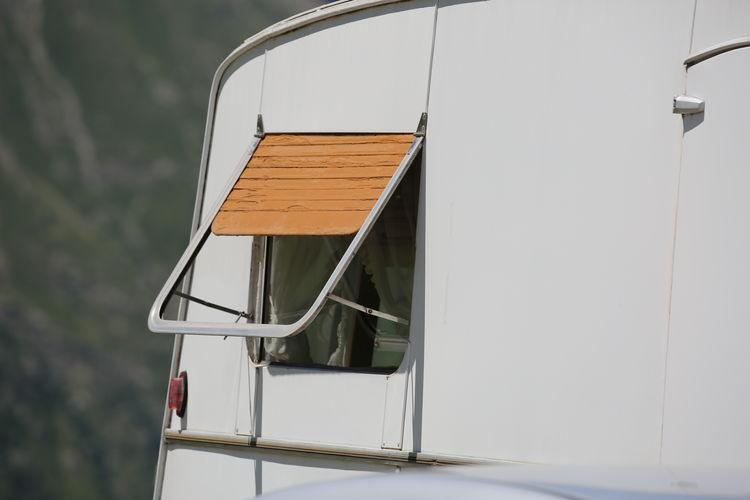 Close-up of open window on van