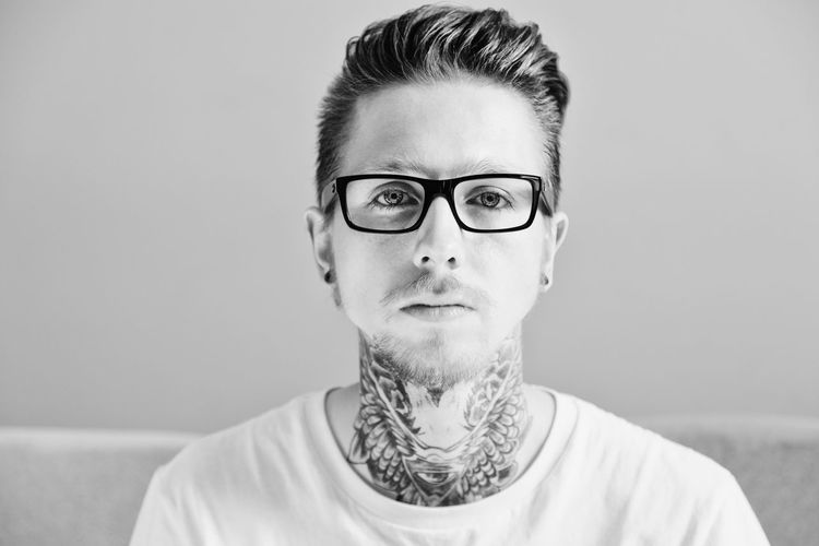 man in glasses with tattoo Adult Adults Only Close-up Day Eyeglasses  Fashion Front View Glasses Headshot Looking At Camera Minimalism One Man Only One Person Only Men People Portrait Real People Studio Shot T-shirt Tattoo Young Adult