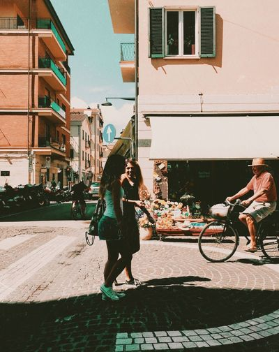 smiling Building Exterior Built Structure Architecture Bicycle Real People Transportation Full Length City Women Sunlight Day Leisure Activity Lifestyles People Street