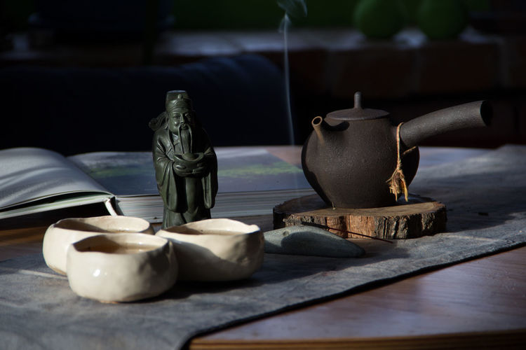 morning tea Morning Ritual Tea Antique Art And Craft Ceramics Chin China Close-up Container Craft Day Household Equipment Incense Incense Sticks Indoors  Kettle Kitchen Utensil No People Old Pottery Still Life Table Teapot Wood - Material