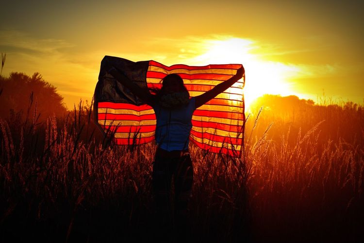 Sunset Silhouette Field Orange Color Nature Beauty In Nature Sky Real People Landscape Outdoors Grass One Person Men Standing Lifestyles Scenics Day USA FLAG USA Photos America American Flag People