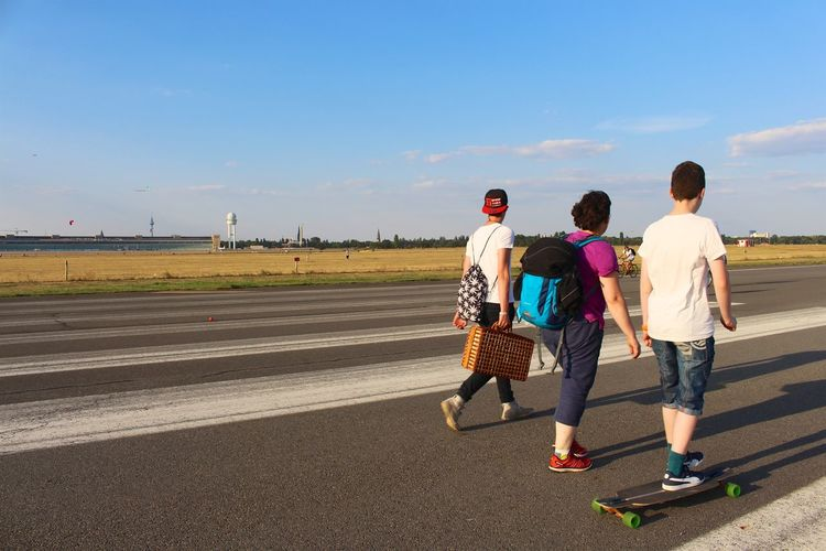 Just people doing their thing on the (former) airstrip of Tempelhofer Feld Blue Sky Cool Cool Kids Hipster Leisure Activity Lifestyles Outdoors Picknick Real People Rear View Relaxing Skateboarding Summer Summertime Sunny Day Tempelhof Tempelhofer Feld Transportation