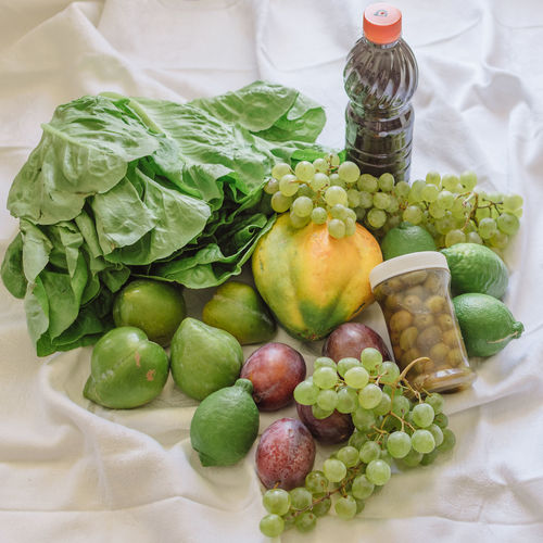 Close-up Day Food Food And Drink Freshness Fruits Grape Green Color Healthy Eating High Angle View Indoors  Lettuce No People Olives Organic Food Papaya Produce Still Life Vegetable Vitamins Wine Grocery Shopping Organic Markets