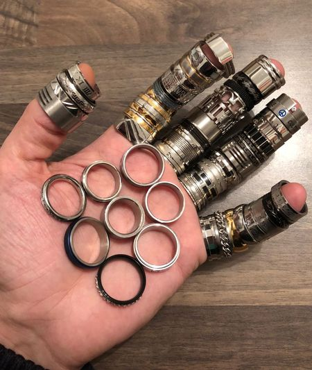 Cropped hand with various rings at table