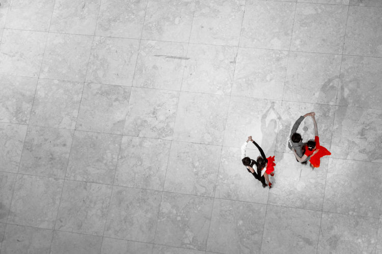 High angle view of couple dancing on tiled floor