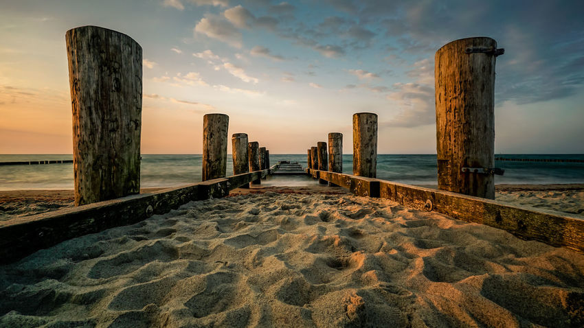 The sun goes down on the beach of Kühlungsborn Baltic Sea Epic Shot Photography Ostsee Beach Beauty In Nature Cloud - Sky Horizon Horizon Over Water Idyllic Land Landscape_photography Long Nature No People Outdoors Post Scenics - Nature Sea Sky Sunset Tranquil Scene Tranquility Water Wood - Material Wooden Post