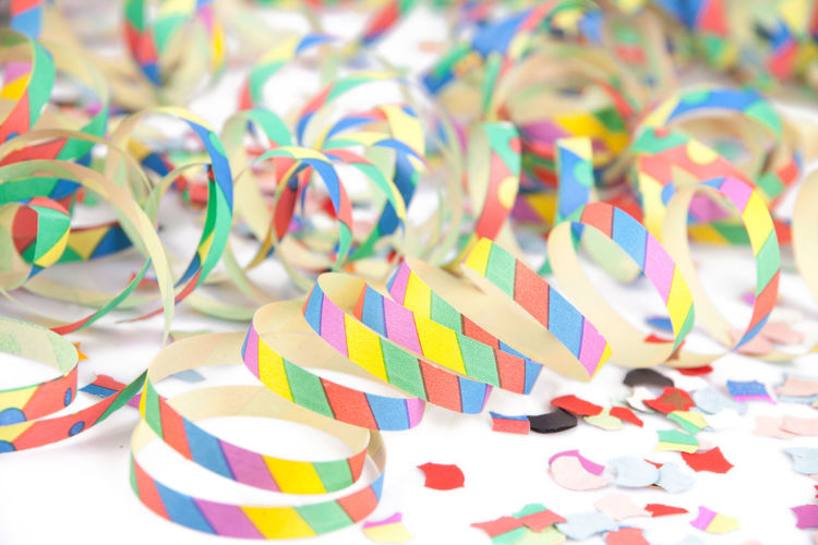 Close-up of colorful confetti on table